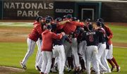 Washington Nationals players celebrate after Game 4 of the baseball National League Championship Series Tuesday, Oct. 15, 2019, in Washington. The Nationals won 7-4 to win the series 4-0. (AP Photo/Alex Brandon) *8 FILE **