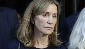 This Sept. 13, 2019, file photo shows actress Felicity Huffman leaving federal court after her sentencing in a nationwide college admissions bribery scandal in Boston. (AP Photo/Elise Amendola, File)