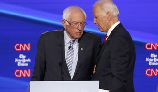 Democratic presidential candidate Sen. Bernie Sanders, I-Vt., left, and former Vice President Joe Biden talk following a Democratic presidential primary debate hosted by CNN/New York Times at Otterbein University, Tuesday, Oct. 15, 2019, in Westerville, Ohio. (AP Photo/John Minchillo)