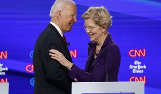 Democratic presidential candidate former Vice President Joe Biden, left, talks with Sen. Elizabeth Warren, D-Mass., during a Democratic presidential primary debate hosted by CNN/New York Times at Otterbein University, Tuesday, Oct. 15, 2019, in Westerville, Ohio. (AP Photo/John Minchillo)