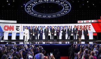 From left, Democratic presidential candidates, Rep. Tulsi Gabbard, D-Hawaii, businessman Tom Steyer, Sen. Cory Booker, D-N.J., Sen. Kamala Harris, D-Calif., Sen. Bernie Sanders, I-Vt., former Vice President Joe Biden, Sen. Elizabeth Warren, D-Mass., South Bend Mayor Pete Buttigieg, entrepreneur Andrew Yang, former Texas Rep. Beto O'Rourke, Sen. Amy Klobuchar, D-Minn., and former Housing Secretary Julian Castro stand on stage for a photo before a Democratic presidential primary debate hosted by CNN and The New York Times at Otterbein University, Tuesday, Oct. 15, 2019, in Westerville, Ohio. (AP Photo/John Minchillo)