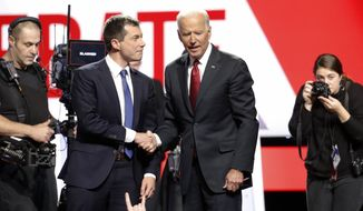 Democratic presidential candidate South Bend Mayor Pete Buttigieg, left, and former Vice President Joe Biden talk on stage following a Democratic presidential primary debate hosted by CNN/New York Times at Otterbein University, Tuesday, Oct. 15, 2019, in Westerville, Ohio. (AP Photo/John Minchillo) ** FILE **