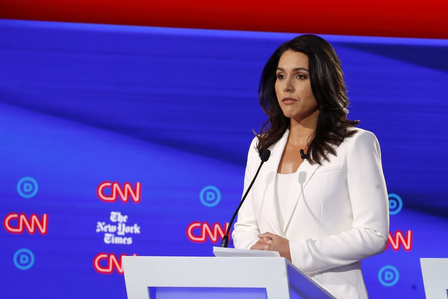Democratic presidential candidate Rep. Tulsi Gabbard, D-Hawaii, listens during a Democratic presidential primary debate hosted by CNN/New York Times at Otterbein University, Tuesday, Oct. 15, 2019, in Westerville, Ohio. (AP Photo/John Minchillo)