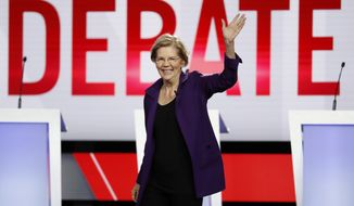 Sen. Elizabeth Warren, D-Mass., participates in a Democratic presidential primary debate hosted by CNN/New York Times at Otterbein University, Tuesday, Oct. 15, 2019, in Westerville, Ohio. (AP Photo/John Minchillo)