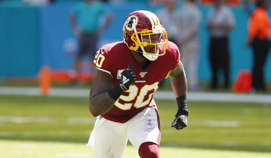 Washington Redskins strong safety Landon Collins (20) runs, during the first half at an NFL football game against the Miami Dolphins, Sunday, Oct. 13, 2019, in Miami Gardens, Fla. (AP Photo/Wilfredo Lee) ** FILE **