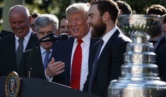 President Donald Trump jokes with St. Louis Blues finals MVP Ryan O'Reilly during an event to honor the 2019 Stanley Cup Champion St. Louis Blues hockey team, in the Rose Garden of the White House, Tuesday, Oct. 15, 2019, in Washington. (AP Photo/Evan Vucci)