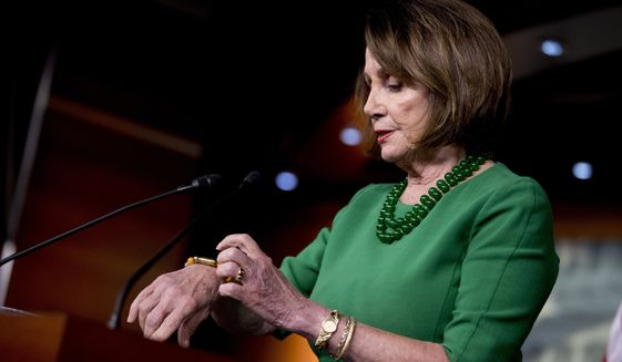 House Speaker Nancy Pelosi of Calif., talks about a bracelet made from a bullet for anti-gun legislation during a news conference on Capitol Hill in Washington, Tuesday, Oct. 15, 2019. (AP Photo/Andrew Harnik)