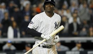 New York Yankees' Didi Gregorius reacts after flying out with two runners on baser to end the fifth inning in Game 3 of baseball's American League Championship Series against the Houston Astros Tuesday, Oct. 15, 2019, in New York. (AP Photo/Matt Slocum)