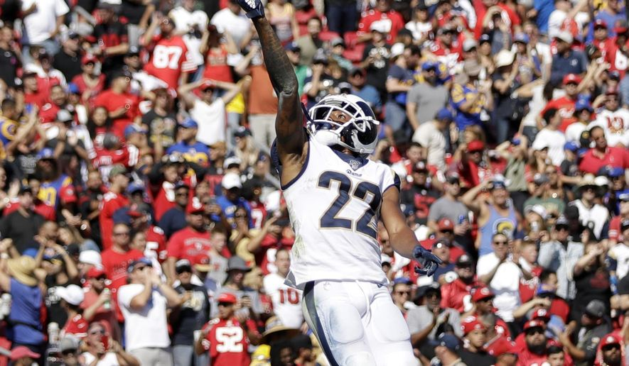 Los Angeles Rams cornerback Marcus Peters (22) jumps after intercepting a pass in the end zone during the first half of an NFL football game against the San Francisco 49ers Sunday, Oct. 13, 2019, in Los Angeles. (AP Photo/Alex Gallardo)