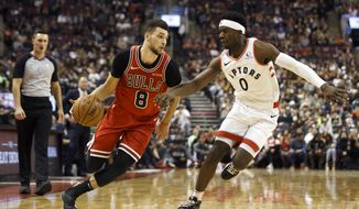 Chicago Bulls guard Zach LaVine (8) drives against Toronto Raptors guard Terence Davis (0) during the first half of their NBA basketball game in Toronto, Sunday, Oct. 13, 2019. (Cole Burston/The Canadian Press via AP)