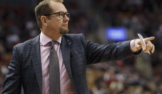 Toronto Raptors head coach Nick Nurse points during the first half of a preseason NBA basketball game against the Chicago Bulls in Toronto, Sunday, Oct. 13, 2019. (Cole Burston/The Canadian Press via AP)