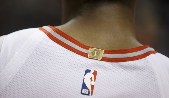 A championship tab is sewn to the back of the jersey of Toronto Raptors guard Cameron Payne during the second half of a preseason NBA basketball game against the Chicago Bulls in Toronto, Sunday, Oct. 13, 2019. (Cole Burston/The Canadian Press via AP)