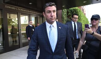 FILE - In this Monday, July 1, 2019, file photo, U.S. Rep. Duncan Hunter leaves federal court after a motions hearing in San Diego. On Monday, Oct. 14, 2019, indicted Hunter argued that he is the best candidate to hold his Southern California seat in a field of rival Republicans and suggested they should look elsewhere for political opportunities. (AP Photo/Denis Poroy, File)