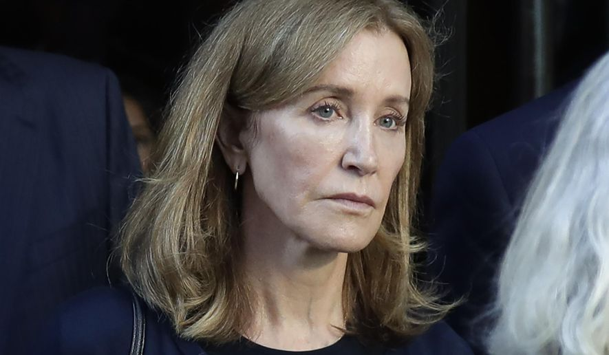 This Sept. 13, 2019, file photo shows actress Felicity Huffman leaving federal court after her sentencing in a nationwide college admissions bribery scandal in Boston. A representative for Huffman says she reported to a federal prison in California to serve a two-week sentence on Tuesday, Oct. 15. (AP Photo/Elise Amendola, File)