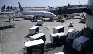 FILE - In this July 18, 2018, file photo a United Airlines commercial jet sits at a gate at Terminal C of Newark Liberty International Airport in Newark, N.J. United Continental Holdings, Inc. reports financial results Tuesday, Oct. 14, 2019. (AP Photo/Julio Cortez, File)