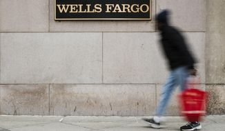 FILE - This Nov. 29, 2018, file photo shows a Wells Fargo bank location in Philadelphia. Wells Fargo & Co. reports financial results Tuesday, Oct. 14, 2019. (AP Photo/Matt Rourke, File)