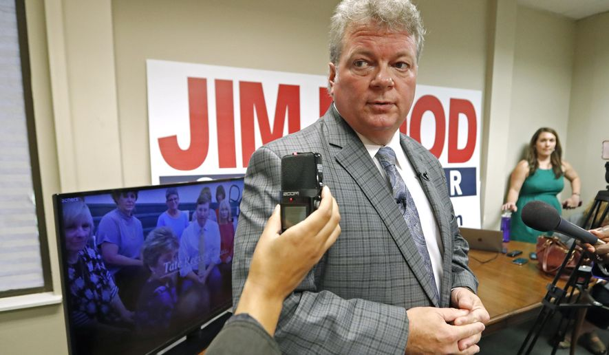 "Democratic Attorney General Jim Hood calls on his gubernatorial opponent, Republican Lt. Gov. Tate Reeves, to remove a ""misleading"" television ad supporting public school education that was partially filmed at a private school, during a news conference, Tuesday, Oct. 15, 2019, in Jackson, Miss. (AP Photo/Rogelio V. Solis)"