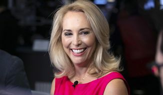 FILE - In this Oct. 22, 2018, file photo, former CIA operative Valerie Plame is interviewed on the floor of the New York Stock Exchange. New Mexico candidates in open races for the U.S. House and Senate are collecting campaign cash at a rapid pace even as many Democratic contenders forgo contributions from corporate political committees. Plame said Monday, Oct. 14, 2019, in a statement that her campaign raised about $447,000 in contributions from July through September as she runs for a northern New Mexico congressional seat. (AP Photo/Richard Drew, File)