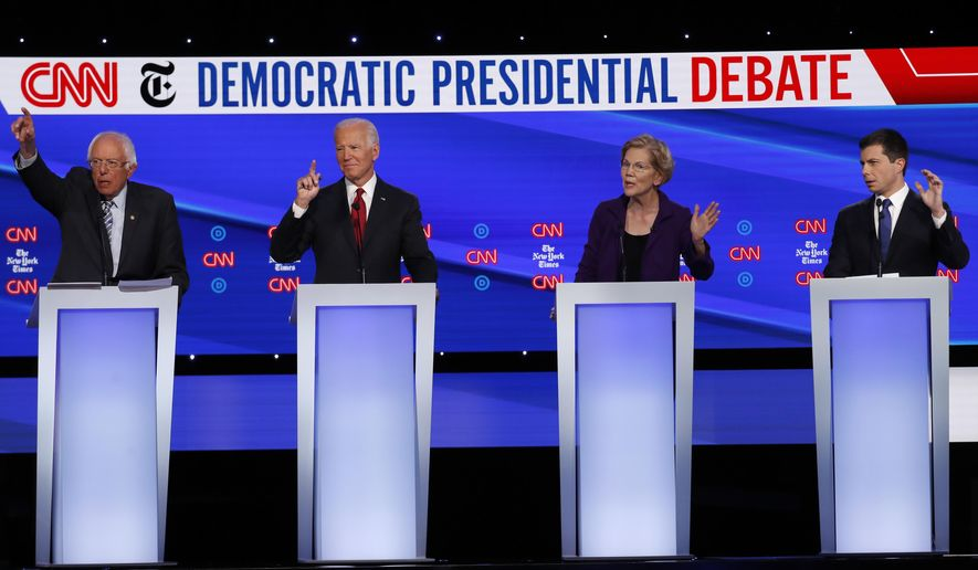 Democratic presidential candidate Sen. Bernie Sanders, I-Vt., from left, former Vice President Joe Biden, Sen. Elizabeth Warren, D-Mass., and South Bend Mayor Pete Buttigieg all gesture to speak during a Democratic presidential primary debate hosted by CNN/New York Times at Otterbein University, Tuesday, Oct. 15, 2019, in Westerville, Ohio. (AP Photo/John Minchillo)