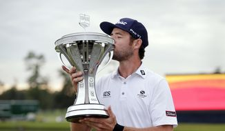 Lanto Griffin kisses the championship trophy during presentation ceremonies after winning the Houston Open golf tournament Sunday, Oct, 13, 2019, in Houston. (AP Photo/Michael Wyke) **FILE**