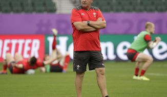 Wales coach Warren Gatland watches during training at the Oita Stadium in Oita, Japan, Tuesday Oct. 8, 2019. Wales will play against Fiji in their Rugby World Cup Pool D game on Oct. 9. (AP Photo/Aaron Favila)