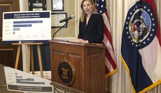 Missouri Auditor Nicole Galloway speaks to reporters Tuesday, Oct. 15, 2019, at her office in the state Capitol in Jefferson City, Mo. Galloway said Missouri isn't saving enough money for a recession. She recommended that lawmakers boost the Budget Reserve Fund to the maximum allowed under the state constitution and create a new fund to save even more. (AP Photo/David A. Lieb)