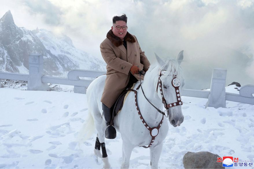 "In this undated photo provided on Wednesday, Oct. 16, 2019, by the North Korean government, North Korean leader Kim Jong Un rides a white horse to climb Mount Paektu, North Korea. Independent journalists were not given access to cover the event depicted in this image distributed by the North Korean government. The content of this image is as provided and cannot be independently verified. Korean language watermark on image as provided by source reads: ""KCNA"" which is the abbreviation for Korean Central News Agency. (Korean Central News Agency/Korea News Service via AP)"