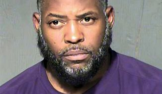 FILE - This undated file photo provided by the Maricopa County Sheriff's Department shows Abdul Malik Abdul Kareem, a Phoenix man who was convicted of providing guns to two friends who launched a 2015 attack on a Prophet Muhammad cartoon contest in suburban Dallas. A court hearing Tuesday, Oct. 15, 2019, in Phoenix is focusing on the FBI's failure to disclose surveillance video taken of the two friends of Kareem's on the day before they left Arizona to launch the attack in Garland. Kareem claims the video would have helped his defense. (Maricopa County Sheriff's Department via AP, File)