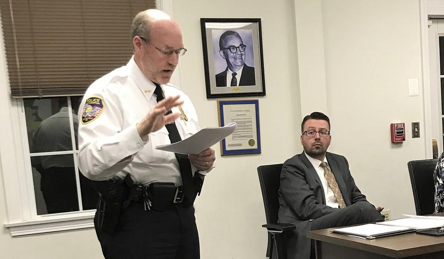In this Nov. 14, 2018 photo, East Hampton, Conn., Police Chief Dennis Woessner addresses the Town Council in East Hampton. Chief Woessner has concluded that an officer's membership in a far-right group infamous for engaging in violent clashes at political rallies didn't violate any department policies. Woessner said that officer Kevin P. Wilcox is no longer associated with the Proud Boys group. (Jeff Mill/ Hearst Connecticut Media via AP)