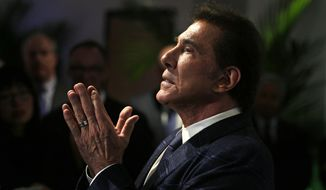 FILE - In this March 15, 2016, file photo, casino mogul Steve Wynn gestures listens during a news conference in Medford, Mass. Nevada's gambling regulators have filed a complaint against the former casino magnate that could bar him from ever working in the gaming industry in the state. The state's Gaming Control Board filed a complaint Monday, Oct. 14, 2019, listing sexual misconduct allegations that have been lodged against the mogul since January 2018. (AP Photo/Charles Krupa, File)
