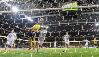 Sweden's Marcus Berg scores the opening goal during the Euro 2020 Group F qualification soccer match between Sweden and Spain at Friends Arena in Solna, Stockholm, Sweden, on Tuesday Oct. 15, 2019. (Anders Wiklund/ TT via AP)