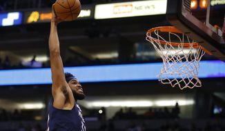 Minnesota Timberwolves center Karl-Anthony Towns dunks against the Phoenix Suns during the first half of a preseason NBA basketball game Tuesday, Oct. 8, 2019, in Phoenix. (AP Photo/Rick Scuteri)