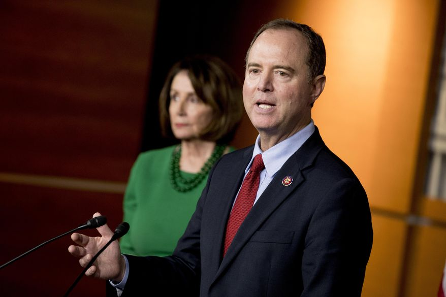 Rep. Adam Schiff, D-Calif., Chairman of the House Intelligence Committee, right, accompanied by House Speaker Nancy Pelosi of Calif., left, speaks about the House impeachment inquiry into President Donald Trump at a news conference on Capitol Hill in Washington, Tuesday, Oct. 15, 2019. (AP Photo/Andrew Harnik)