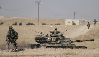 Turkish tanks and troops stationed near Syrian town of Manbij, Syria, Tuesday. Oct. 15, 2019. Russia moved to fill the void left by the United States in northern Syria on Tuesday, deploying troops to keep apart advancing Syrian government and Turkish forces.(Ugur Can/DHA via AP)