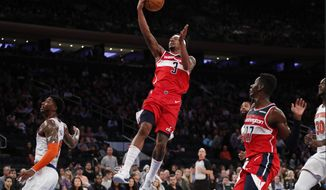 Washington Wizards guard Bradley Beal (3) leaps for a layup during the first half of the team's preseason NBA basketball game against the New York Knicks in New York, Friday, Oct. 11, 2019. (AP Photo/Kathy Willens)