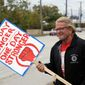 John Harbert, a 42-year General Motors employee, and others are expected to continue picketing outside the GM Fabrication Division through Friday as bargainers for General Motors and the United Auto Workers iron out details of a tentative contract. (Associated Press)