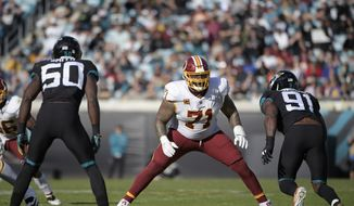 In this Dec. 16, 2018, file photo, Washington Redskins offensive tackle Trent Williams (71) sets up to block in front of Jacksonville Jaguars defensive end Yannick Ngakoue (91) during the second half of an NFL football game in Jacksonville, Fla. Browns general manager John Dorsey acknowledged having a few conversations lately with Redskins GM Bruce Allen. With the trading deadline approaching, Dorsey could be tempted to improve Clevelands offensive line and the Redskins are at an impasse with seven-time Pro Bowl left tackle Trent Williams, who hasnt played this season due to a contract holdout. As he finished his news conference Wednesday, Oct. 16, 2019, Dorsey was asked if he has asked Allen about trading Williams.It takes two to tango, Dorsey said as he left the podium.(AP Photo/Phelan M. Ebenhack, File) **FILE**
