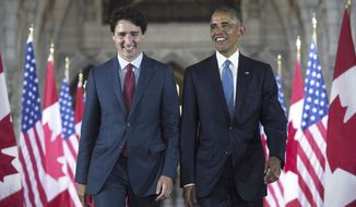 FILE - In this June 29, 2016, file photo, U.S. President Barack Obama and Canada Prime Minister Justin Trudeau walk down the Hall of Honour on Parliament Hill in Ottawa,. In a message on Twitter, Wednesday, Oct. 16, 2019, Obama says the world needs progressive leadership and he hopes Canadians will give Trudeau another term as prime minister. (Paul Chiasson/The Canadian Press via AP, File)