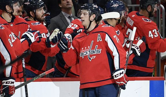 Washington Capitals defenseman John Carlson (74) celebrates his goal during the second period of the team's NHL hockey game against the Toronto Maple Leafs, Wednesday, Oct. 16, 2019, in Washington. (AP Photo/Nick Wass) ** FILE **