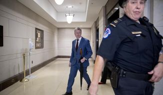 Kurt Volker, a former special envoy to Ukraine, leaves a closed door meeting on Capitol Hill in Washington, Wednesday, Oct. 16, 2019, after testifying before congressional lawmakers as part of the House impeachment inquiry into President Donald Trump. (AP Photo/Andrew Harnik)