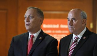 Rep. Andy Biggs, R-Ariz., left, and Rep. Louie Gohmert, R- Texas, right, are part of a group that talks with reporters on Capitol Hill in Washington, Wednesday, Oct. 16, 2019, outside the room where people are interviewed for the impeachment inquiry. (AP Photo/Susan Walsh) ** FILE **