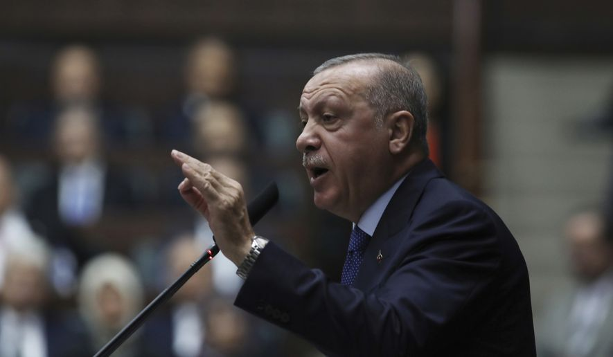 Turkish President Recep Tayyip Erdogan addresses his ruling party legislators at the Parliament, in Ankara, Wednesday, Oct 16, 2019. Erdogan called Wednesday on Syrian Kurdish fighters to leave a designated border area in northeast Syria 'as of tonight' for Turkey to stop its military offensive, defying pressure on him to call a ceasefire and halt its incursion into Syria.(AP Photo/Burhan Ozbilici)