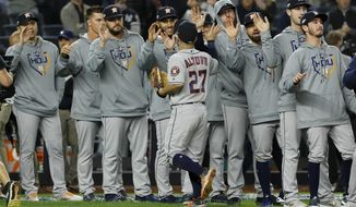 Houston Astros second baseman Jose Altuve celebrates with teammates after their 4-1 win against the New York Yankees in Game 3 of baseball's American League Championship Series Tuesday, Oct. 15, 2019, in New York. (AP Photo/Matt Slocum)