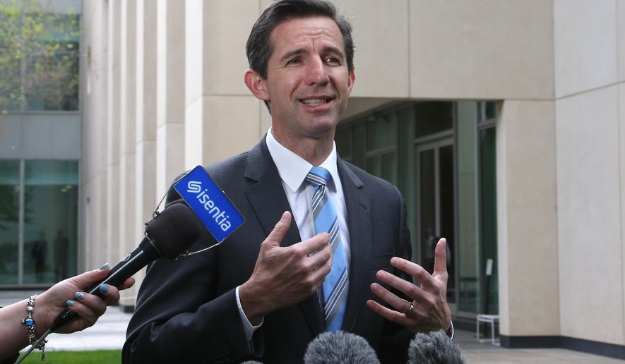 Australia's Trade Minister Simon Birmingham addresses media outside the Parliament House in Canberra, Australia, Wednesday, Oct. 16, 2019. Birmingham says he wants bilateral free trade deals with Hong Kong, Indonesia and Peru to take effect early next year. (AP Photo/Rod McGuirk)