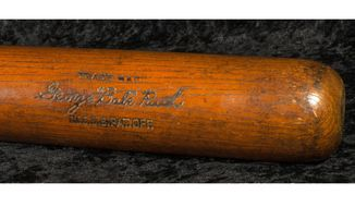 This Oct. 11, 2019 photo released by SCP Auctions, Inc., shows the bat used by Babe Ruth to slug his 500th career home run in 1929. Ruth became the first player to reach the coveted plateau on Aug. 11, 1929, hitting a solo shot for the New York Yankees off Willis Hudlin at League Park in Cleveland. The bat is going up for auction, nearly 75 years after he gave it to a friend whose family has kept it ever since. (SCP Auctions, Inc. via AP)