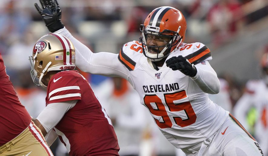 Cleveland Browns defensive end Myles Garrett (95) sacks San Francisco 49ers quarterback Jimmy Garoppolo during the first half of an NFL football game in Santa Clara, Calif., Monday, Oct. 7, 2019. (AP Photo/Tony Avelar)
