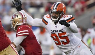 Cleveland Browns defensive end Myles Garrett (95) sacks San Francisco 49ers quarterback Jimmy Garoppolo during the first half of an NFL football game in Santa Clara, Calif., Monday, Oct. 7, 2019. (AP Photo/Tony Avelar)