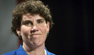 FILE - In this Nov. 6, 2018, file photo, Amy McGrath speaks to supporters in Richmond, Ky. The retired Marine combat pilot is showing her mettle as a campaign fundraiser, hauling in more than $10.7 million since starting her campaign against Senate Republican Leader Mitch McConnell. McGrath has outraised the six-term Kentucky Republican so far this year, but McConnell has more campaign cash in the bank, based on their latest numbers posted by the Federal Election Commission.  (AP Photo/Bryan Woolston, File)
