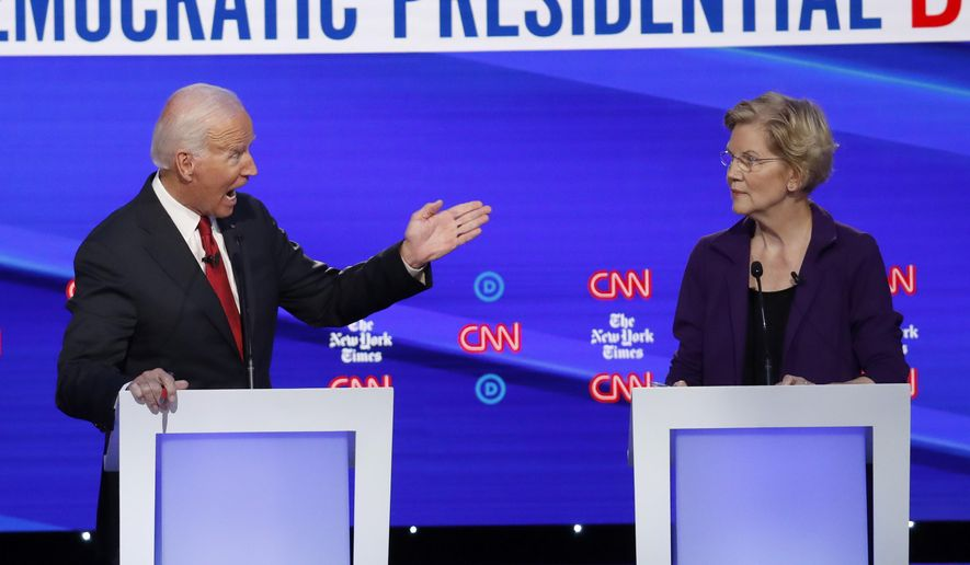 Democratic presidential candidate former Vice President Joe Biden, gestures toward Sen. Elizabeth Warren, D-Mass., during a Democratic presidential primary debate hosted by CNN/New York Times at Otterbein University, Tuesday, Oct. 15, 2019, in Westerville, Ohio. (AP Photo/John Minchillo) ** FILE **