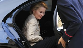 European Commission President Ursula von der Leyen gets in to her car after a meeting with French President lEmmanuel Macron at the Elysee Palace, Monday, Oct. 14, 2019. French President Emmanuel Macron meets European Commission President Ursula von der Leyen ahead of EU summit this week. (AP Photo/Michel Euler)